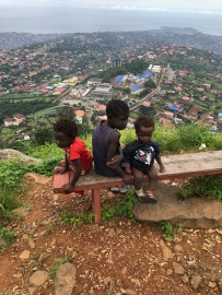Three solitary children on Leicester Peak, overlooking Freetown